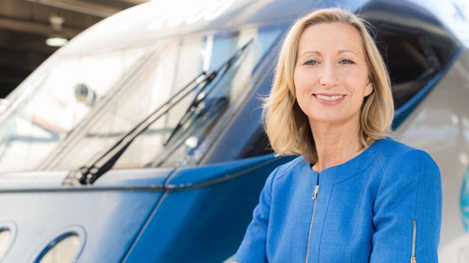 Caroline Decker posing in front of an Amtrak train