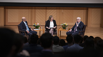 Carlyle Group co-founder David Rubenstein speaks with Georgetown McDonough Dean Paul Almeida and Vice Dean Pietra Rivoli