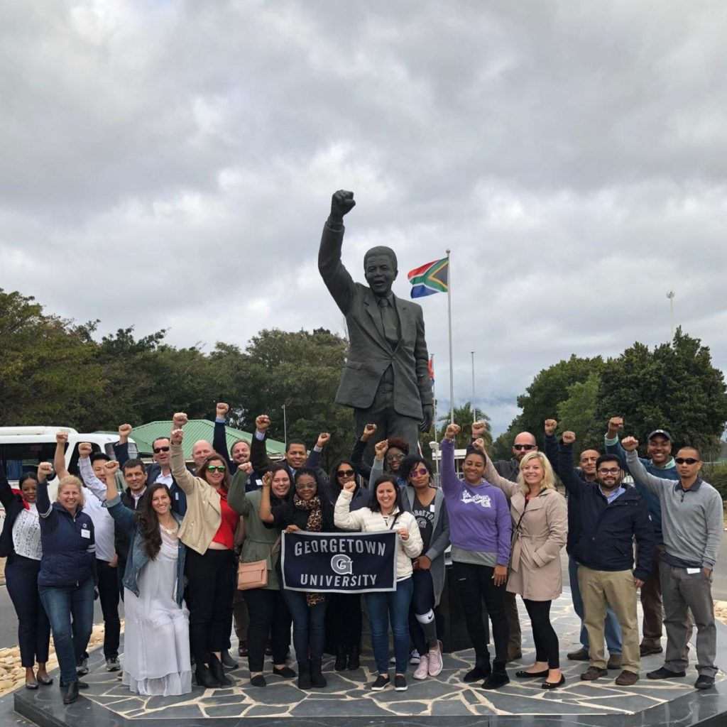 Students in front of Nelson Mandela statue in South Africa.