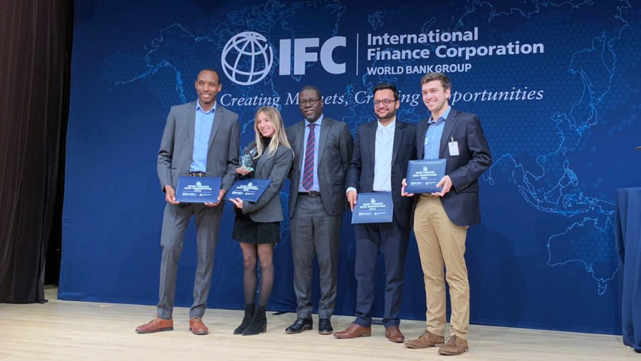 Georgetown students on stage at the IFC accepting their award