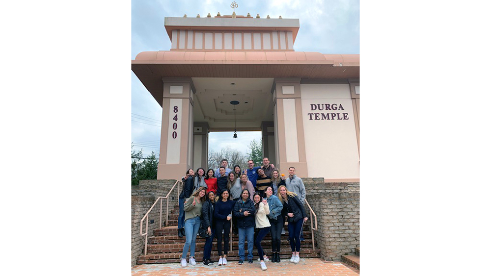 A group of Georgetown undergraduate business students at the entrance of Durga Temple in Northern Virginia