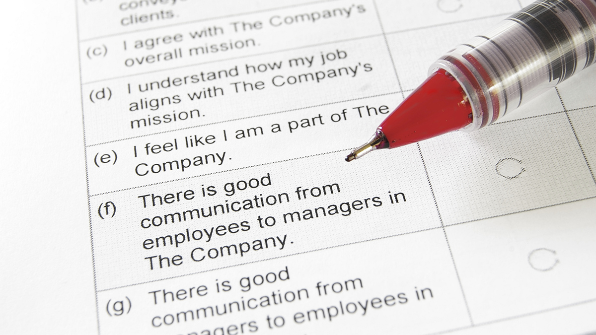 iStock image closeup of a blank employment survey with red pen