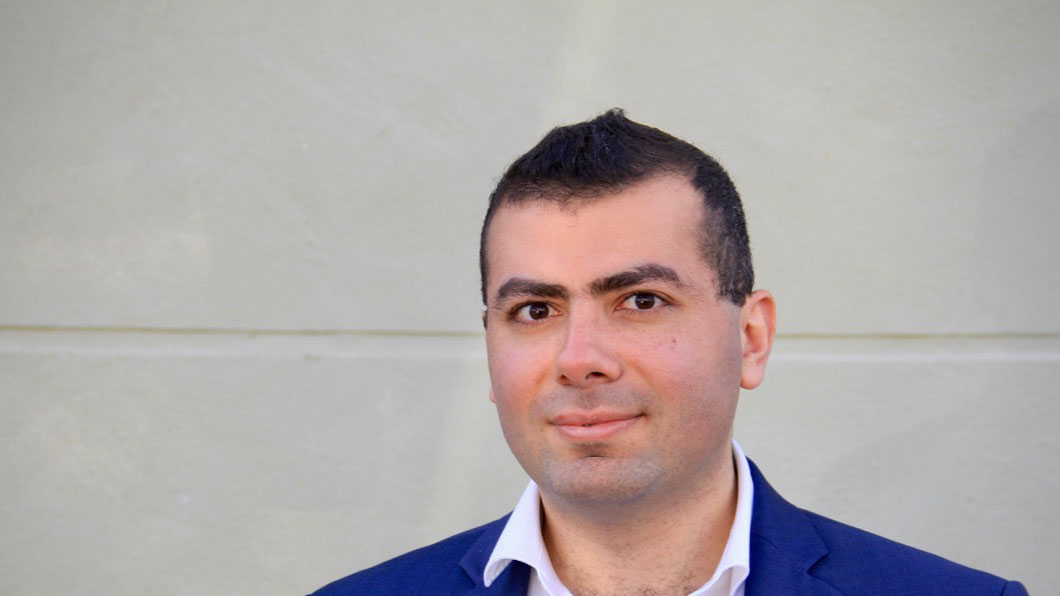 Photo of Sherif Shabana in front of a white wall for HQHQ story.